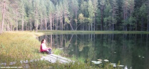 Spirit of Northern Lights - Katja Rusanen meditates in the nature. Photo is from Finland.